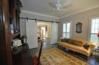Custom Double Barn Doors and Beveled Pine Ceiling