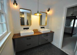 Master bathroom floating vanity with custom butcher block top and dual vessel sinks