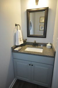 Powder room refresh with new flooring, vanity and paint